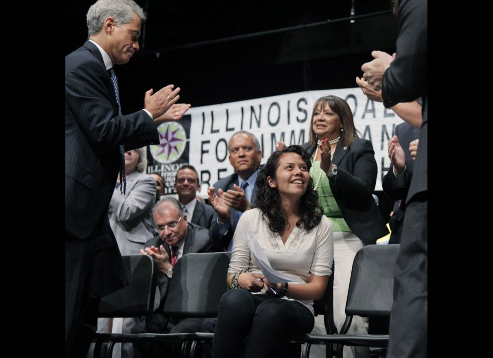 Chicago Mayor Rahm Emanuel, left, joins other officials in giving Arianna Salgado a standing ovation for the speech she gave