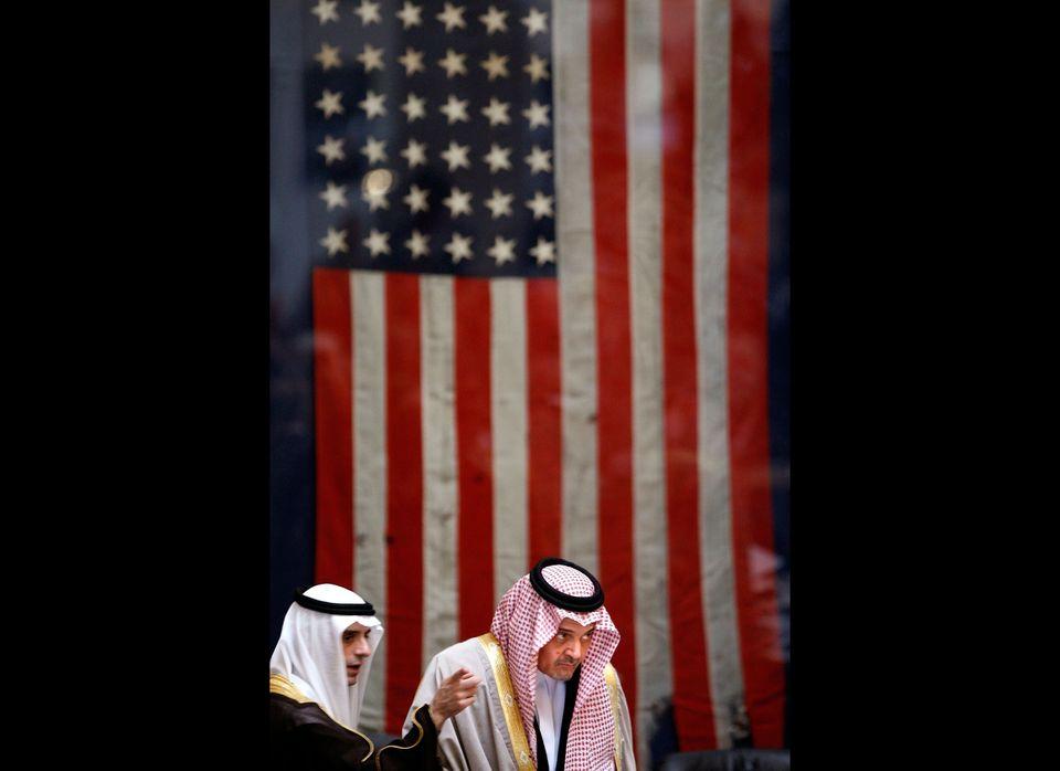 Saudi Arabian ambassador to the United States Adel al-Jubeir (L) talks with Saudi Arabian Foreign Affairs Minister Saud Al-Fa
