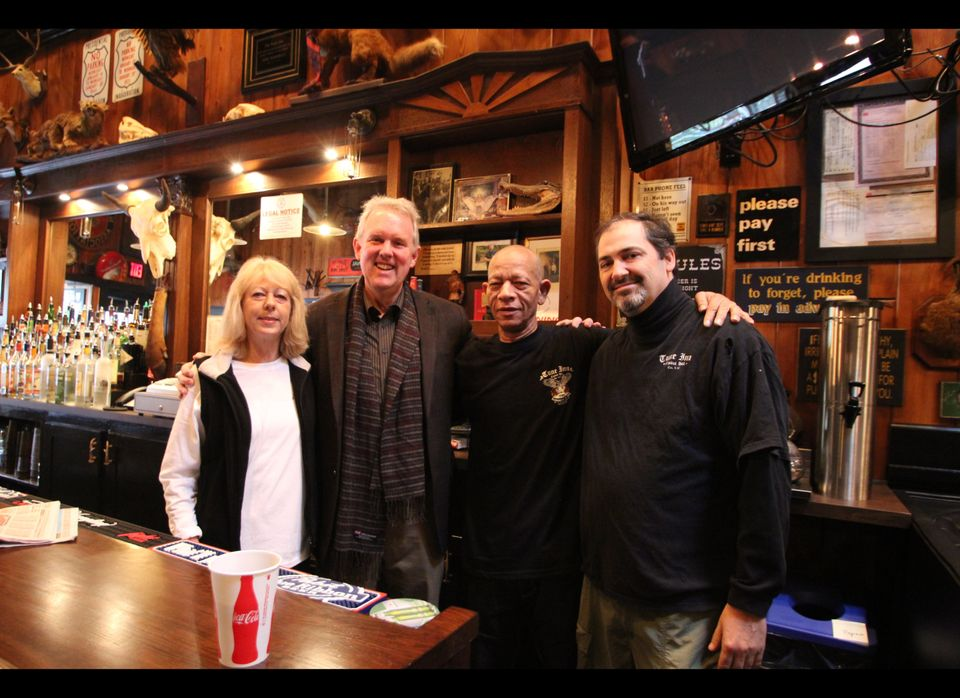 Ward 6 Councilmember Tommy Wells (second from left) poses with Tune Inn employees.