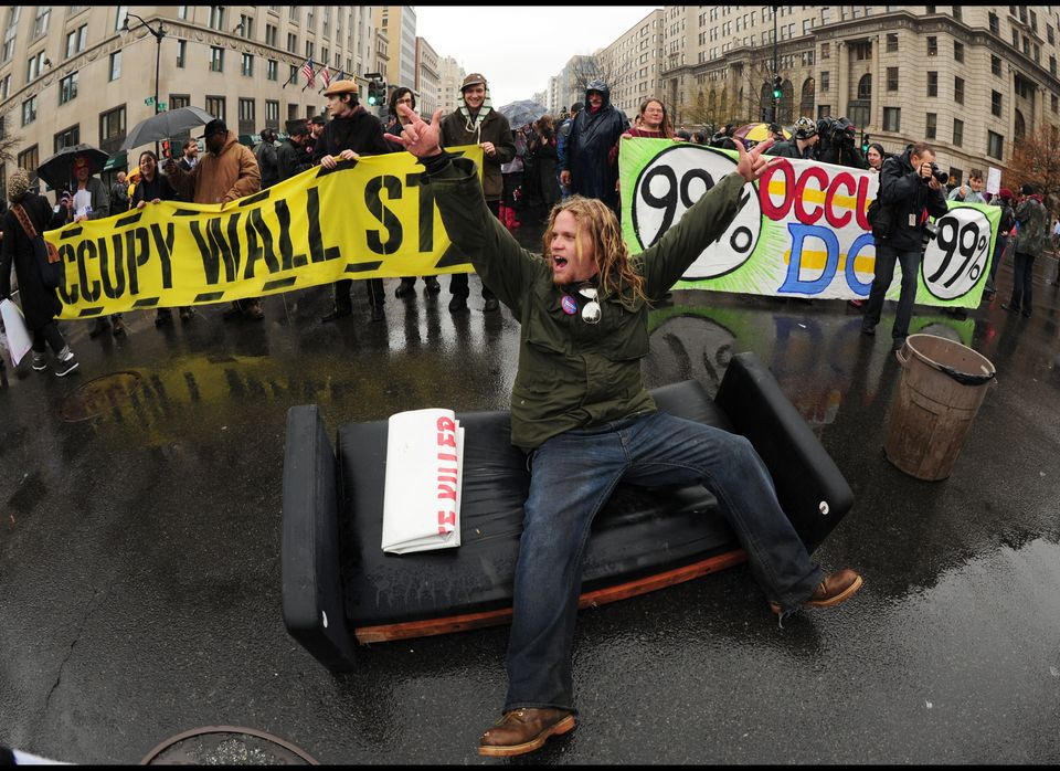 An Occupy DC protester blocks an intersection in downtown D.C. on Dec. 7, 2011.