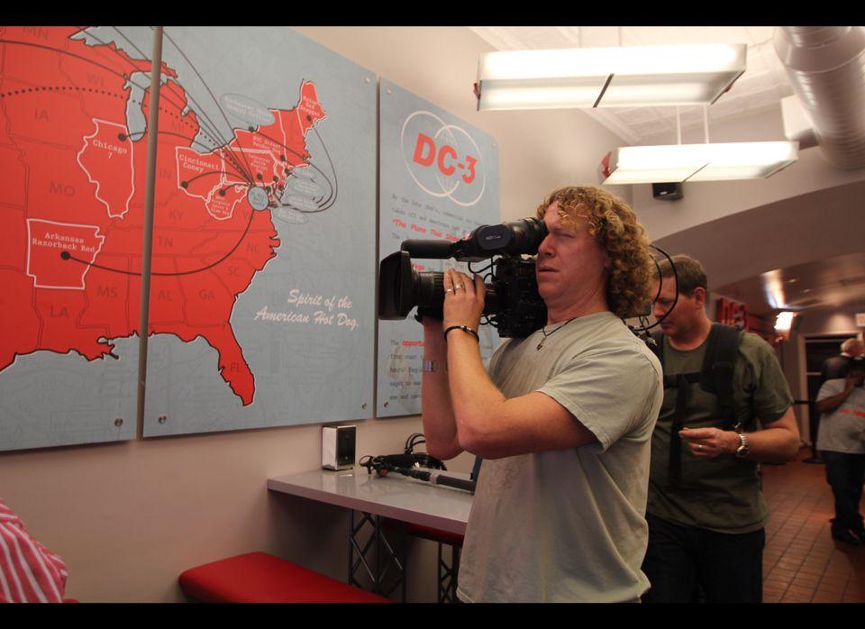 Crew members shoot footage at DC-3, a hotdog spot on Barracks Row.
