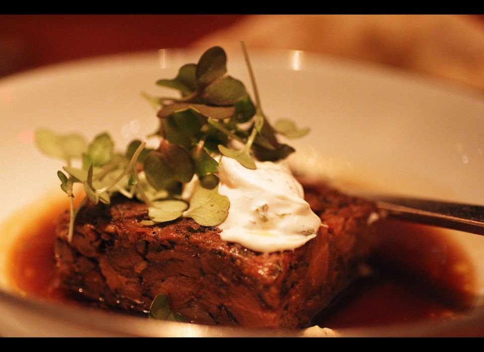 Braised goat with wood-fired flatbread, eggplant jam, minted labneh and arugula.