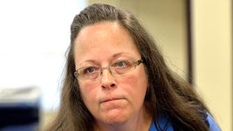 Rowan County Clerk Kim Davis listens to a customer at the Rowan County Courthouse in Morehead, Ky in 2015.  (Photo: Timothy D. Easley/AP)