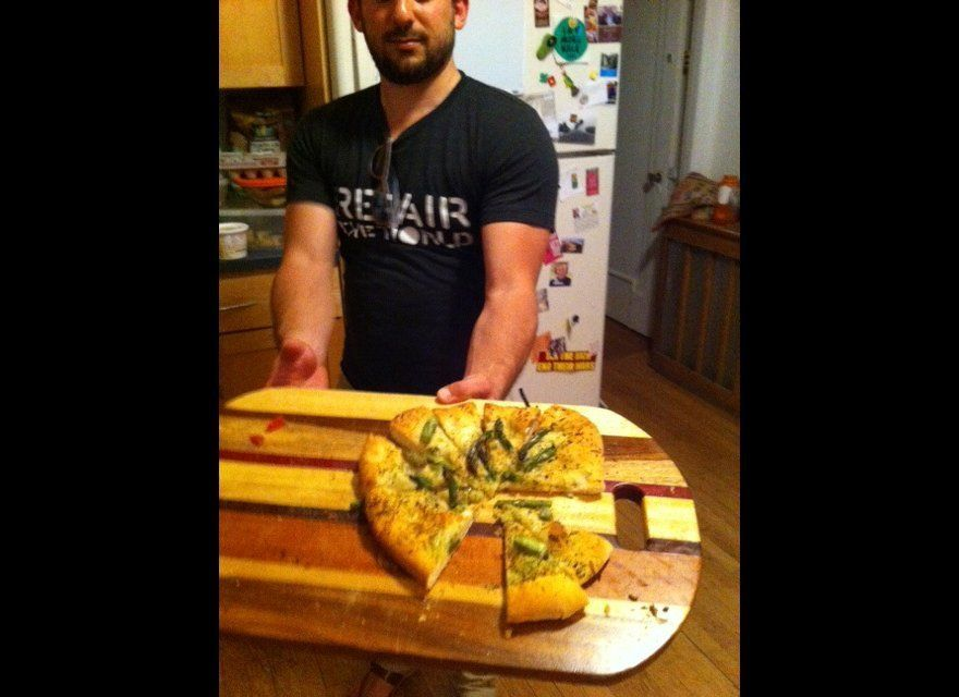 Feastly co-founder Noah Karesh holds out some flatbread. (It was delicious.)