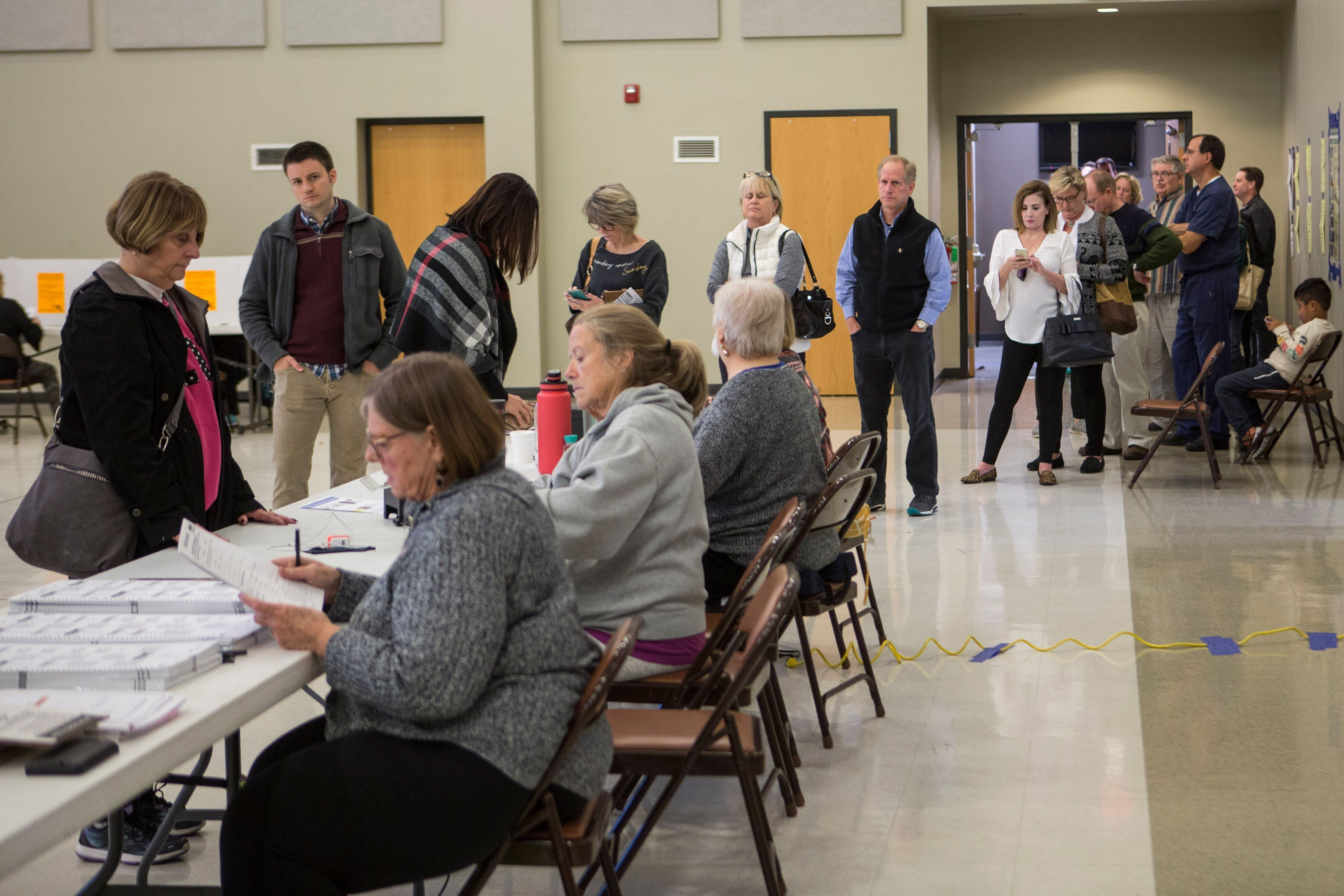 People wait in line to vote at McKnight Crossings Church of Christ in St. Louis on Tuesday, Nov. 6, 2018. (Johanna Huckeba/St. Louis Post-Dispatch via AP)