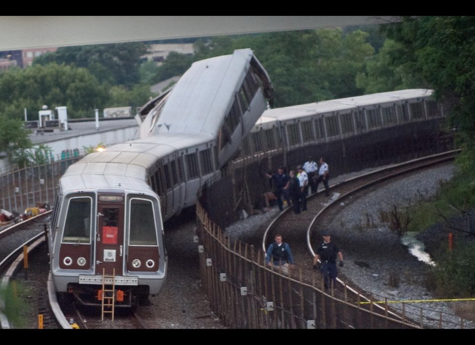 Emergency personnel investigate the scene of a Metro Red Line train collision near the Fort Totten station on June 22, 2009.