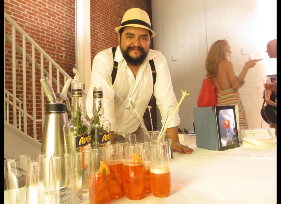 Mixologist JP Caceres poses with the evening's first cocktail.