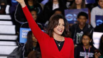 DETROIT, MI - OCTOBER 26: Michigan gubernatorial candidate Gretchen Whitmer walks onto the stage to speak at a Democratic rally attended by former President Barack Obama and former Attorney General Eric Holder at Detroit Cass Tech High School on October 26, 2018 in Detroit, Michigan. Obama, and Holder are among approximately a dozen democrats who were targeted by mail bombs over the past several  days. (Photo by Bill Pugliano/Getty Images)