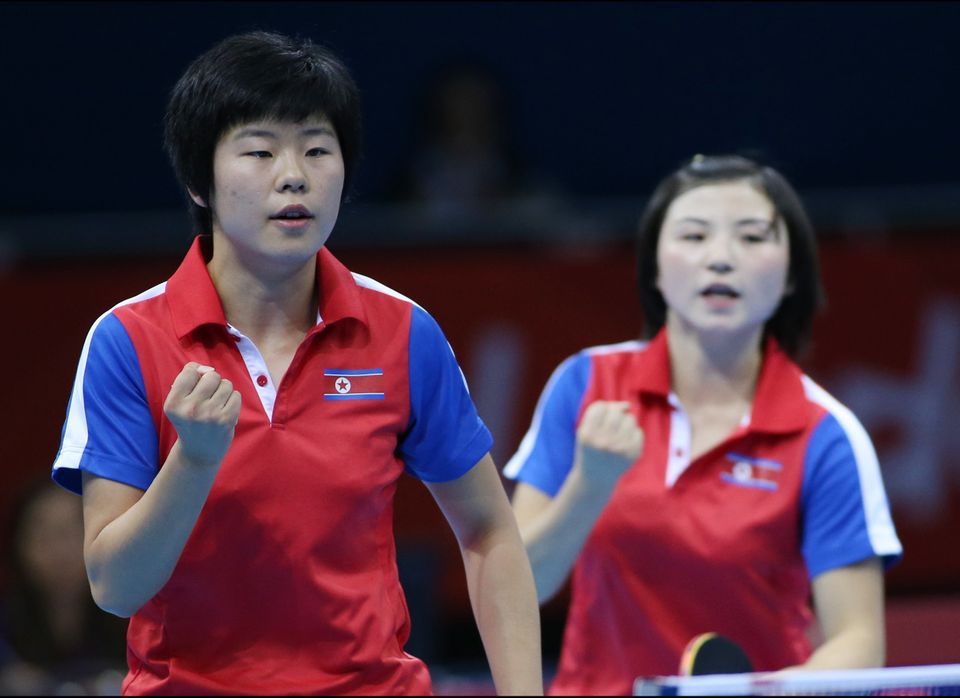 North Korea's Ri Mi Gyong and Kim Jong react during a match against Great Britain's Joanna Parker and Kelly Sibley in the wom