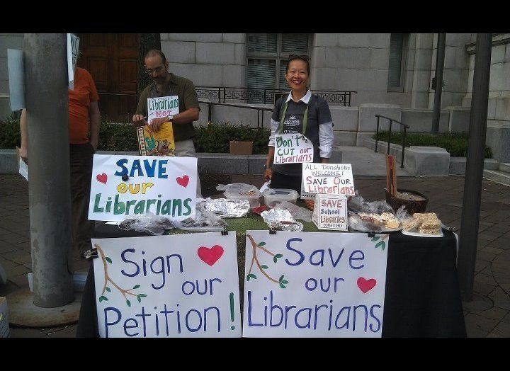 Members of the Capitol Hill Public School Parent Organization hold a bake sale in July outside the John A. Wilson Building to