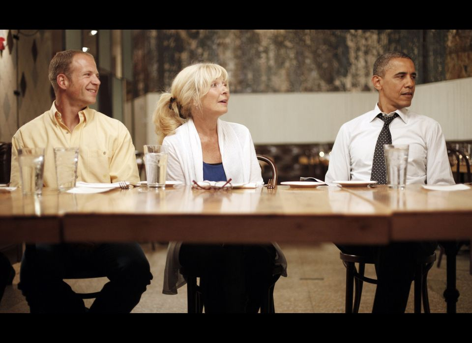 President Barack Obama, right, at Mintwood Place restaurant in the Adams Morgan neighborhood in Washington, with winners of a