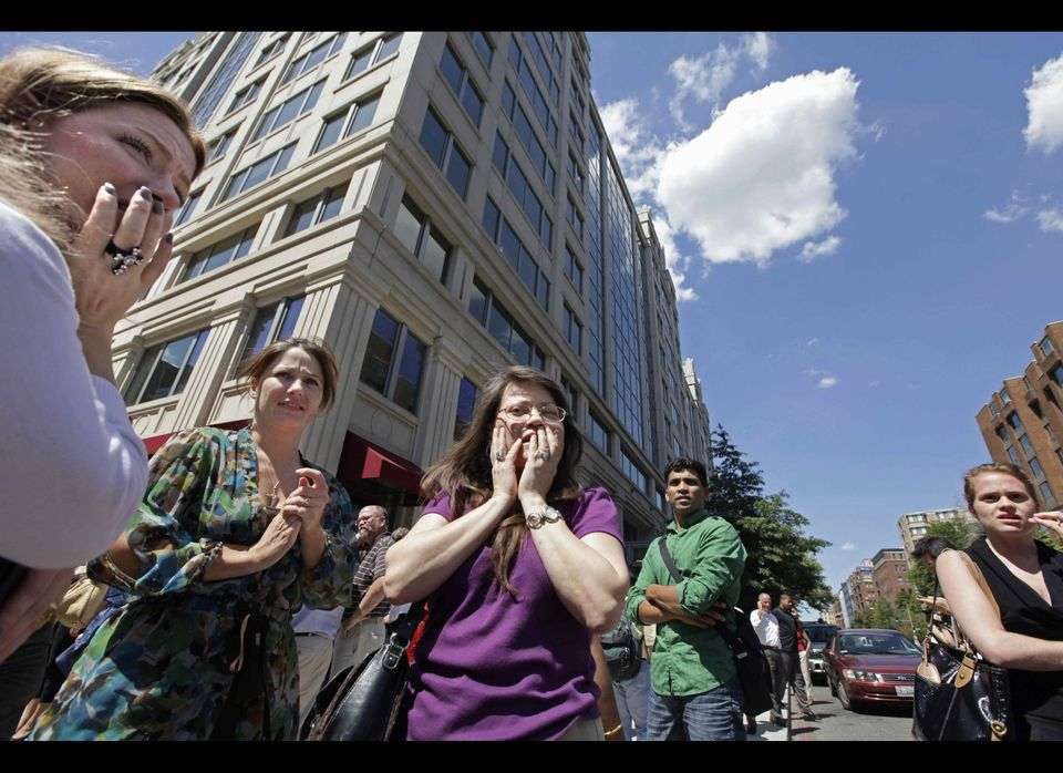 In this Aug. 23, 2011 file photo, office workers gather on the sidewalk in downtown Washington moments after a 5.8 magnitude