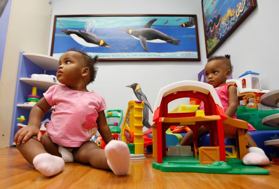 Maria Tapia, and Teresa Tapia play in a playroom at Children's Hospital of Richmond at Virginia Commonwealth University in Ri
