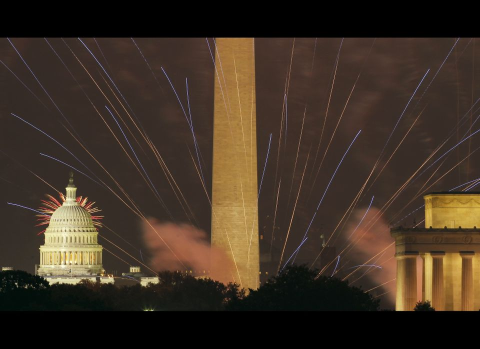Fireworks light the sky over the U.S. Capitol, left, Washington Monument and Lincoln Memorial in Washington on Wednesday, Jul