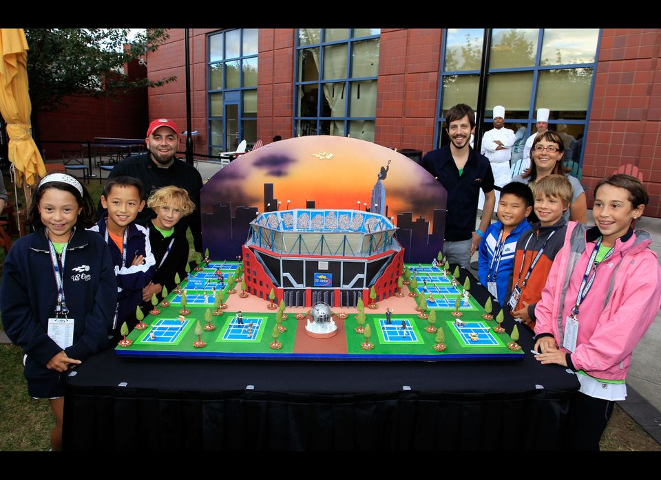 "A replica of the USTA Billie Jean National Tennis Center. Duff Goldman and his ""Ace Of Cake"" co-stars stand with a group of c"