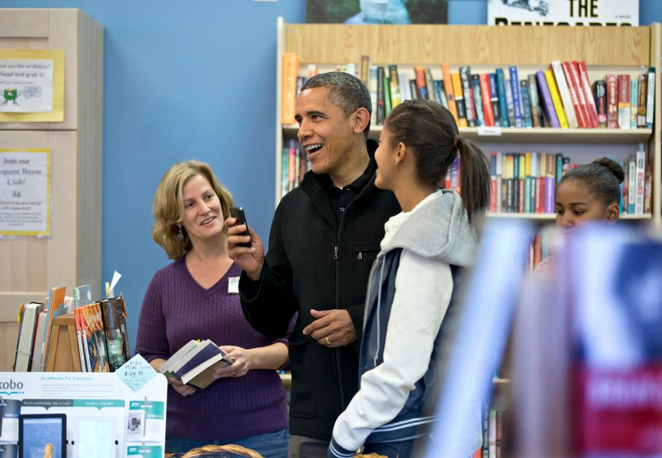 President Barack Obama, with daughters Sasha, far right, and Malia, center, goes shopping at a small bookstore, One More Page