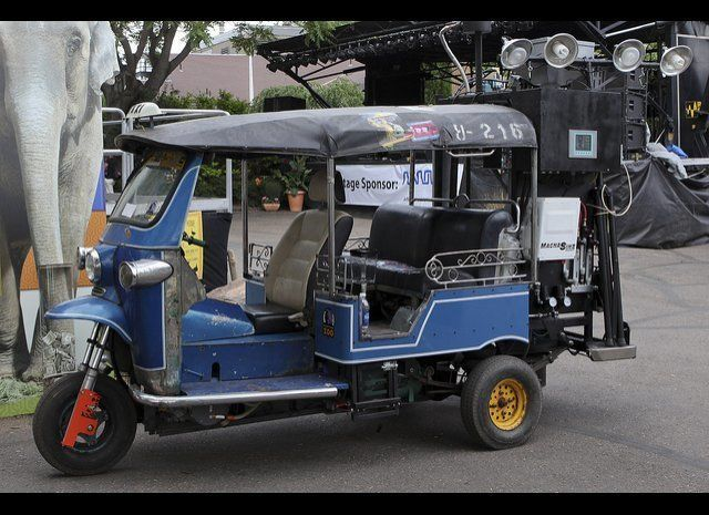 "Denver Zoo will haul its working prototype of a ""gasifier,"" a motorized Tuk Tuk (rickshaw) that runs on animal poop and trash"
