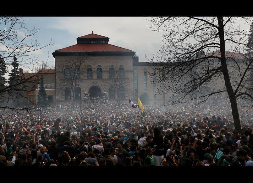 BOULDER, CO - APRIL 20: The haze of marijuana smoke looms over a crowd of thousands at 4:20 pm April 20, 2010 at the Universi
