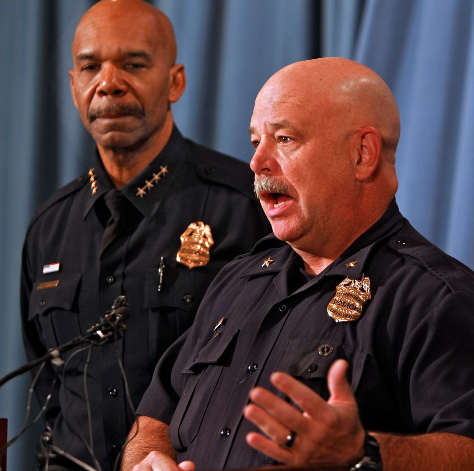 Denver Police Commander Ron Saunier, right, talks about the arrest of three suspects in the murder of five people and a fire