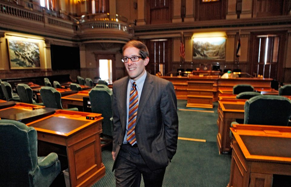 FILE - In this Nov. 14, 2012 file photo, Denver Democratic Rep. Mark Ferrandino leaves the House Chamber at the Capitol in De
