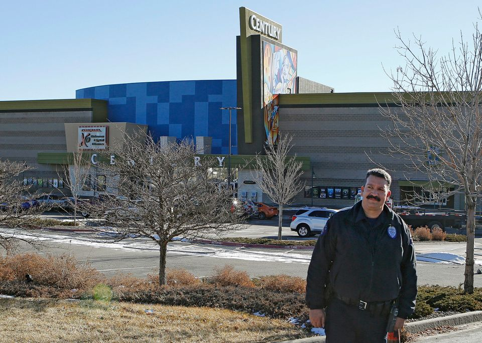 Aurora Police Officer Mike Moore guards the entrance to the Century theater in Aurora, Colo., on Thursday, Jan. 17, 2013. The