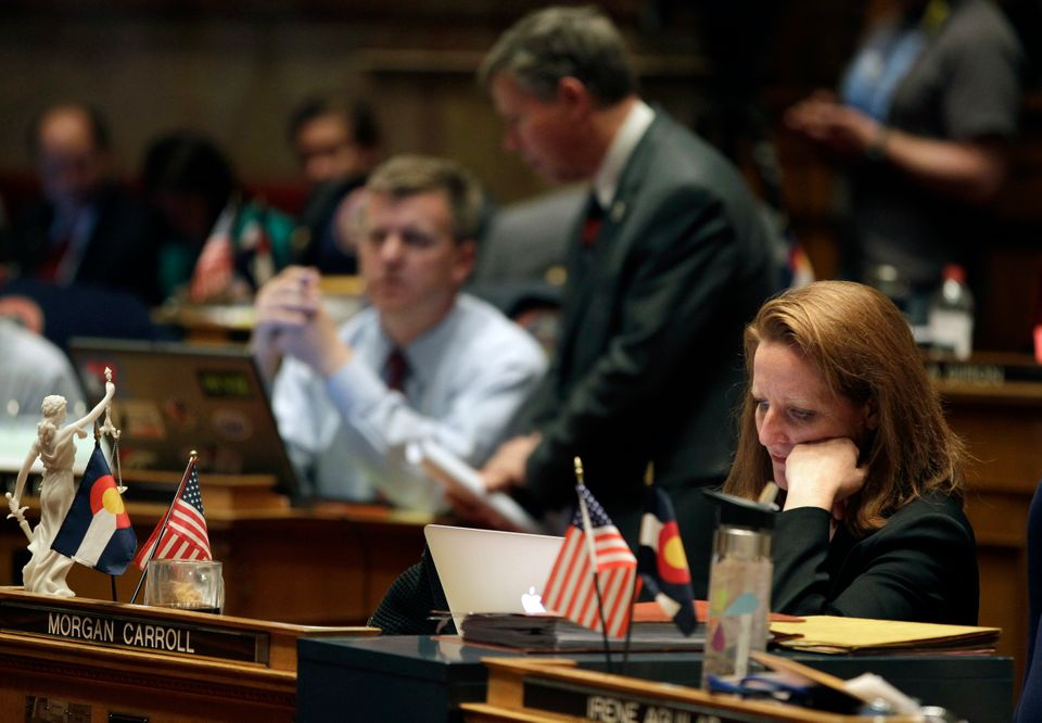 Colorado Senate Democratic Leader Morgan Carroll, whose district includes the Denver suburb Aurora, sits at her desk during a