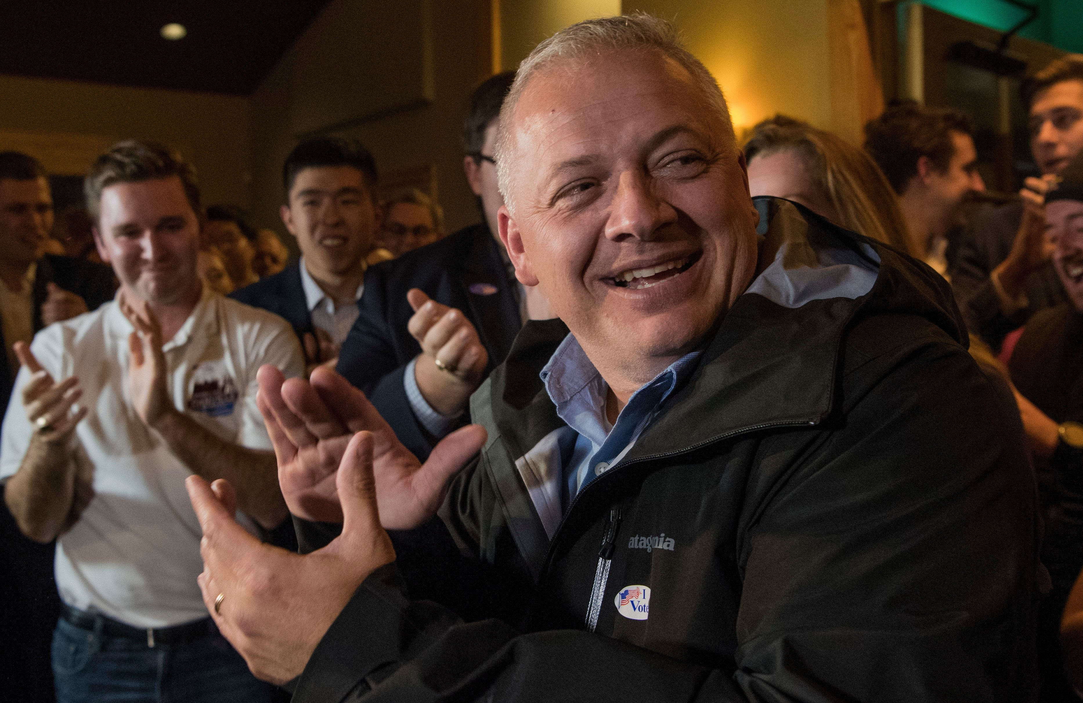 Republican congressional candidate Denver Riggleman claps with the crowd during an election party in Afton, Va., Tuesday, Nov. 6, 2018. (AP Photo/Lee Luther Jr.)