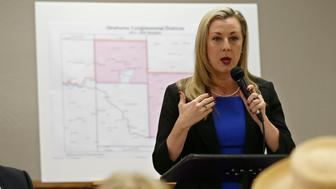 Kendra Horn speaks during a forum for Oklahoma 5th congressional district seat Democratic candidates for the group Edmond Democratic Women in Edmond, Okla., Thursday, May 10, 2018. (AP Photo/Sue Ogrocki)