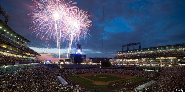 DENVER, CO - JUNE 30:  Baseball fans watch a fireworks show after a game between the San Diego Padres and the Colorado Rockie