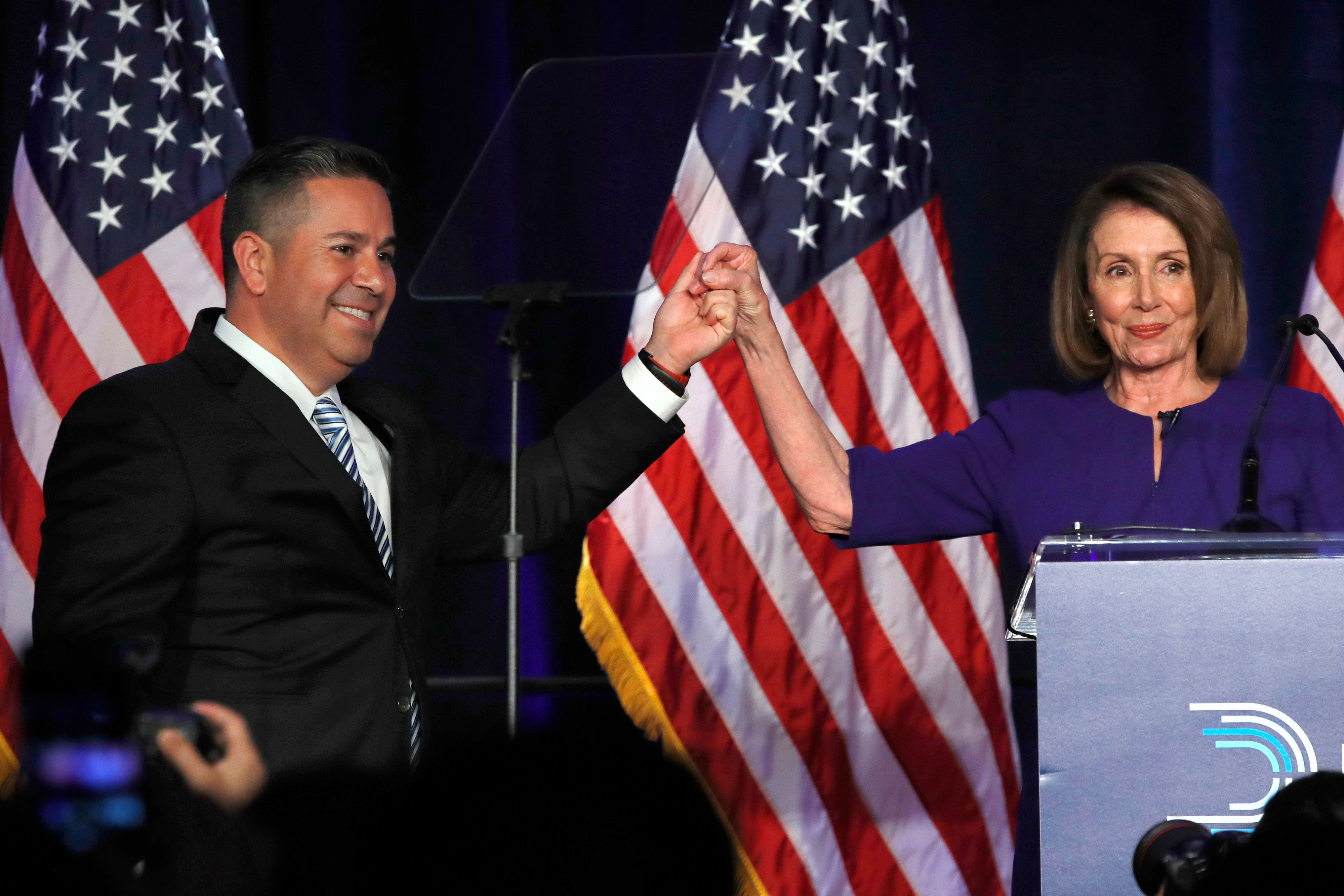 DCCC Chair Ben Ray Luján, left, and House Democratic Leader Nancy Pelosi of Calif., gesture after speaking to a crowd of volunteers and supporters of the Democratic party at an election night event at the Hyatt Regency Hotel, on Tuesday, Nov. 6, 2018, in Washington. (AP Photo/Jacquelyn Martin)