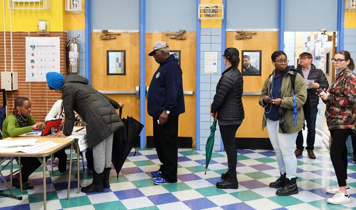 Voters register at a polling station in New York on Nov. 6.