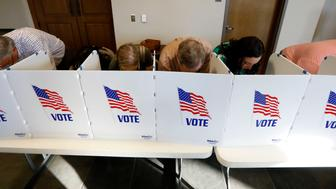 <p> Every voting booth was filled by Madison County voters Tuesday, Nov. 6, 2018, as they filled out their paper ballots in Ridgeland, Miss. Voters have a number of races to consider, including judiciary and federal offices and some local issues. (AP Photo/Rogelio V. Solis) </p>