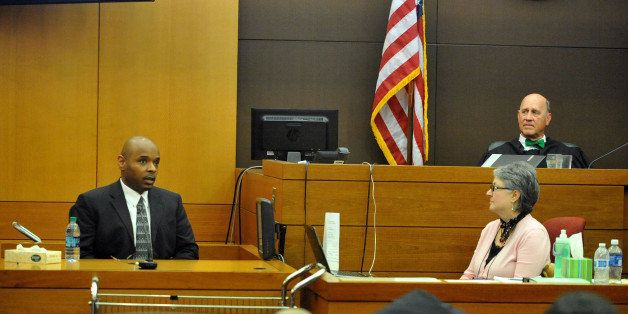 Fulton County Superior Court Judge Jerry Baxter listens as former Dobbs Elementary School teacher Derrick Broadwater testifie