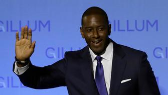 Florida Democratic gubernatorial candidate Andrew Gillum and his wife R. Jai Gillum wave to supporters before delivering his conesssion speech Tuesday, Nov. 6, 2018, in Tallahassee, Fla. Gillum lost to Republican former U.S. Rep. Ron DeSantis. (AP Photo/Chris O'Meara)