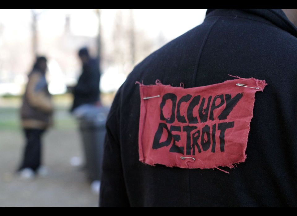 An Occupy Detroit protester on a recent afternoon in Grand Circus Park in Detroit with an Occupy Detroit banner pinned to his