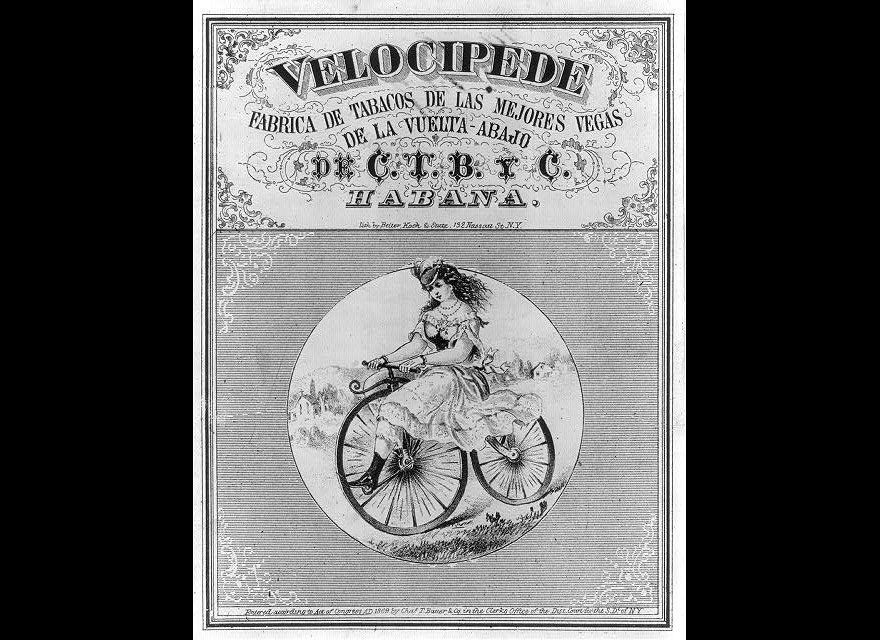 This 1869 lithograph depicts a young woman on a velocipede, an early bike model, with a huge front wheel. Detroit bike histor