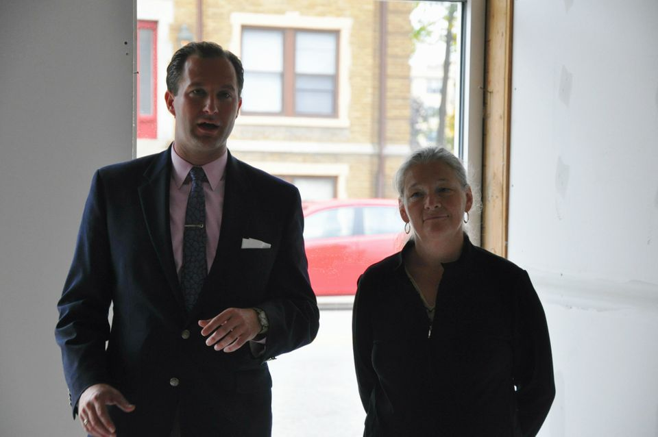 James Van Dyke, vice president of development for the Roxbury Group, and Sue Mosey, president of Midtown, Inc., announced the