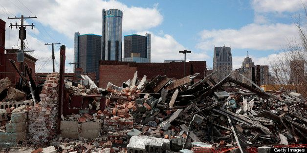 The General Motors Co. (GM) headquarters building is seen in the distance past a past a pile of debris in Detroit, Michigan,