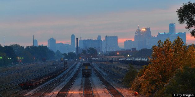 Multiple track lines converge in the foreground and the Detroit syline provides a backdrop. This was taken before dawn in ear