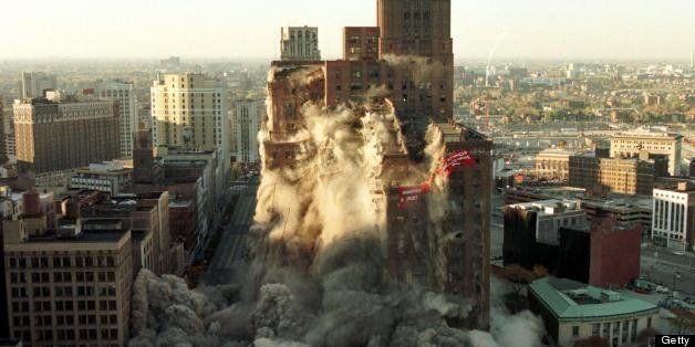 DETROIT, UNITED STATES:  The J.L. Hudson building in downtown Detroit is imploded 24 October using 2,728 pounds of exposives