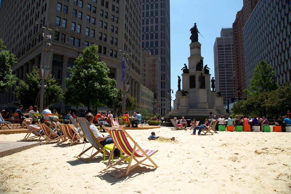 Only in Detroit ... does a billionaire turn a small downtown park into a beach in order to improve downtown.   We love that t