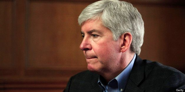 DETROIT, MI - MARCH 1: Michigan Governor Rick Snyder talks with the news media after announcing that he will appoint an Emerg