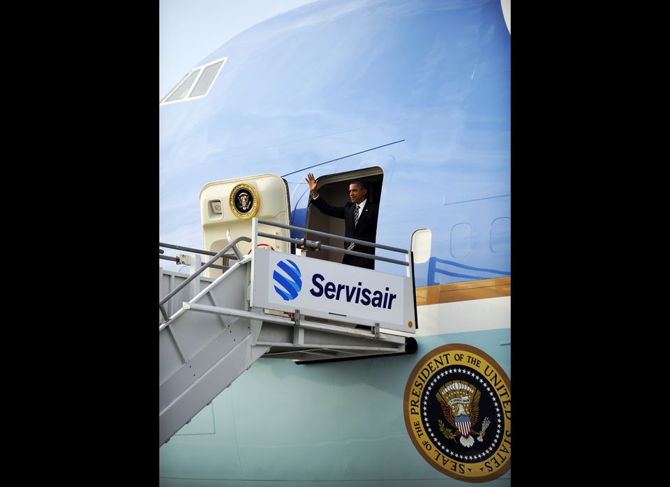US President Barack Obama waves as he disembarks from Air Force One at the Los Angeles International Airport in Los Angeles,