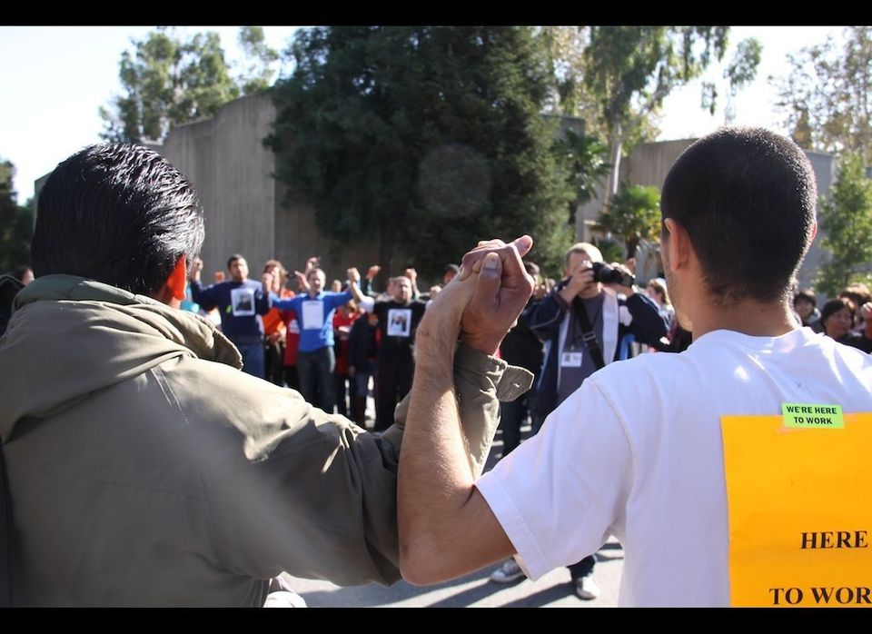 Hundreds protest Pomona College's termination of undocumented workers; 17 arrests made.