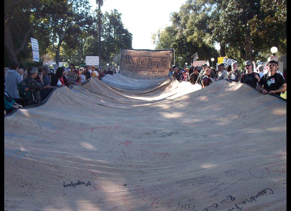 Occupy Rose Parade protestors carry 250-foot Constitution at the Rose Parade 2012. (Huffington Post/Kathleen Miles)