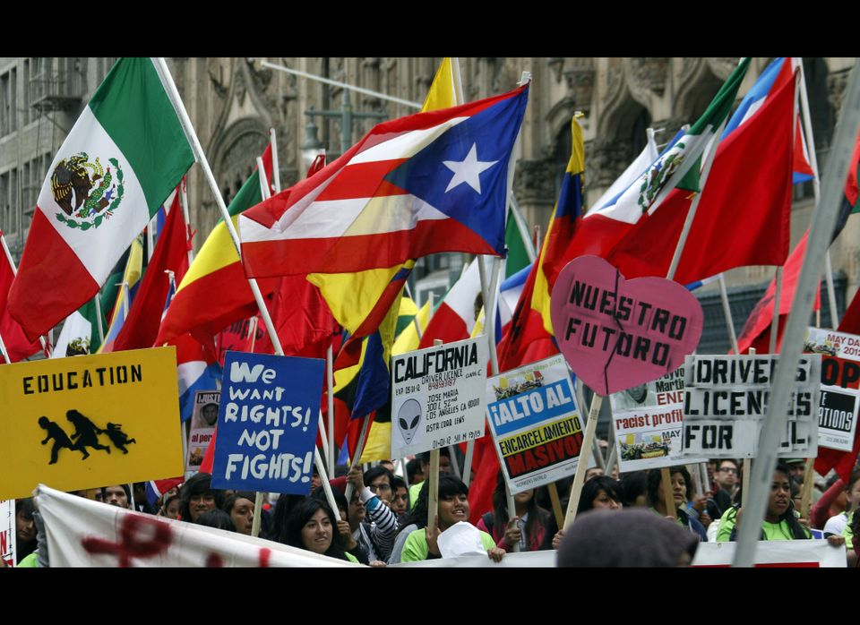 Protest signs and flags of many nations and causes are seen at one of several May Day protests in Los Angeles, Tuesday, May 1