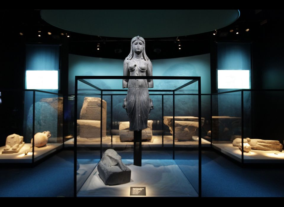 """A Graeco-Egyptian statue, part of the exhibit """"Cleopatra: The Search for the Last Queen of Egypt,"""" is displayed at the Califo"""