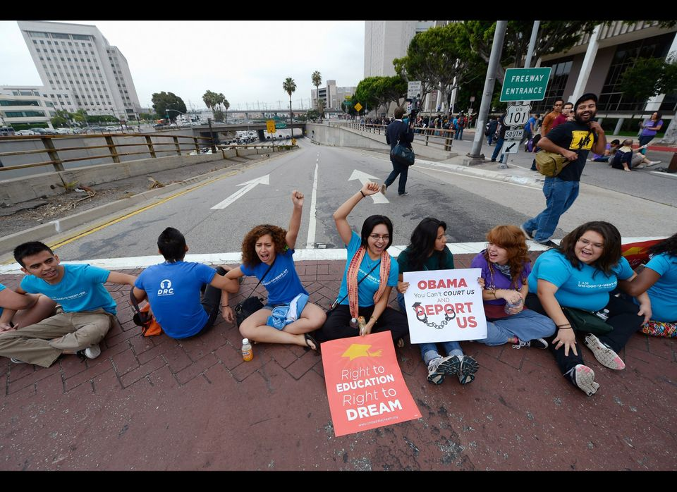 LOS ANGELES, CA - JUNE 15: Students block a on ramp to the US101 during a demonstration by immigrant students for an end to d