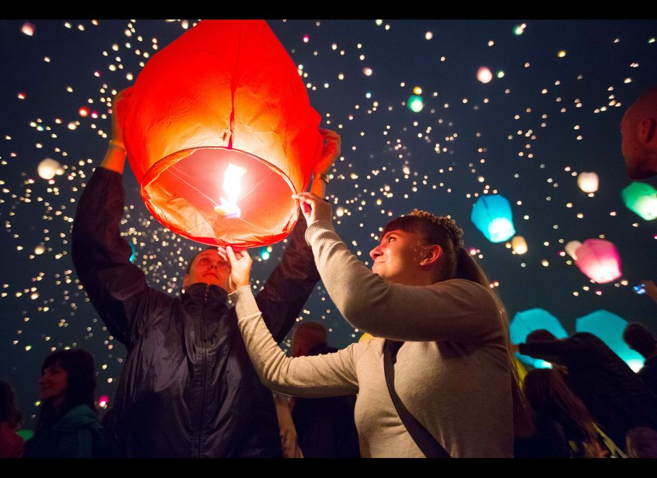 People release lanterns in Poznan, Poland. Thousands of lanterns were released to mark the shortest night of the year. (Photo