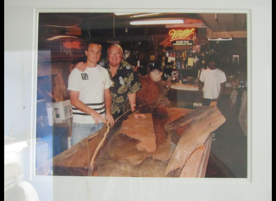 An old photo of Jed and Greg Noll are among many items on display at Noll Surfboards.